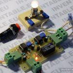 Foto del temporizador con un foco de baja tensión conectado al relé.